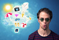 Happy joyful man with sunglasses looking at summer icons Royalty Free Stock Photo