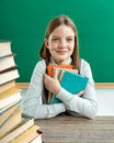 Happy joyful teenage girl reading a book Royalty Free Stock Photo
