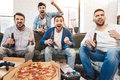 Happy jubilant men expressing their emotions Royalty Free Stock Photo