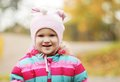 Happy kid in autumn park girl Stock Photography