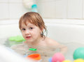 Happy  kid bathes in bath Stock Photo