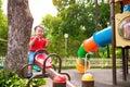 Happy kid boy having fun on playground in park city Royalty Free Stock Photo