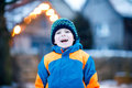 Happy kid boy having fun with snow in winter Royalty Free Stock Photo