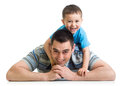 Happy kid boy and his daddy lying on the floor dad Stock Image