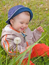 Happy kid on the dandelion meadow Stock Photography