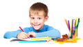 Happy kid is drawing with pencils Stock Photography