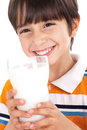 Happy kid drinking glass of milk Stock Photo