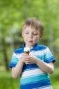 Happy kid eating a tasty ice cream outdoor Stock Photos