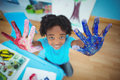 Happy kid enjoying arts and crafts painting with his hands Royalty Free Stock Photography