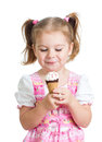 Happy kid girl eating ice cream isolated Stock Photography