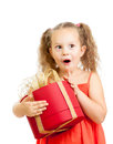 Happy kid girl holding red gift box Stock Photos