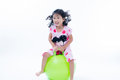 Happy kid girl jumping on bouncing ball Royalty Free Stock Photo