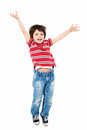 Happy kid jumping for joy studio shot Royalty Free Stock Images