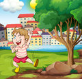A happy kid near the tree at the riverbank beside the tall build illustration of buildings Royalty Free Stock Image