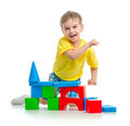 Happy kid playing with colorful blocks on white Royalty Free Stock Photo