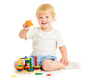 Happy kid playing education toys on floor Stock Images