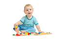 Happy kid playing toys in studio Royalty Free Stock Image
