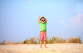 Happy kid raising hands in delight summer seaside Stock Photography