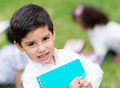 Happy kid at school holding a notebook and smiling Stock Images