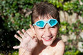 Happy kid in summer with water Royalty Free Stock Images