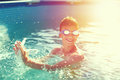 Happy kid with teeth smile splasing in swimming pool vintage sty Royalty Free Stock Photo