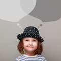 Happy kid thinking and looking up on chat bubbles above Royalty Free Stock Photo