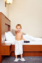 Happy kid watching tv in hotel room after bathing Stock Photo