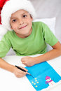 Happy kid writing letter to santa Stock Photo