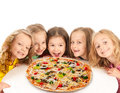 Happy kids with big pizza children isolated on white Stock Photo