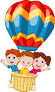 Happy kids cartoon riding a hot air balloon