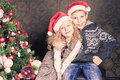 Happy kids at Christmas holiday near decorated christmas tree Royalty Free Stock Photo