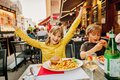 Happy kids eating hamburger with french fries and pizza Royalty Free Stock Photo