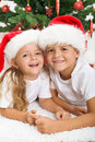 Happy kids in front of christmas tree Royalty Free Stock Photography