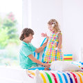 Happy kids having pillow fight Royalty Free Stock Photo