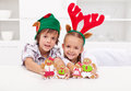 Happy kids holding decorated gingerbread people Stock Images
