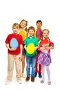 Happy kids holding egg shape colourful cards Royalty Free Stock Photo