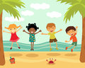 Happy kids jumping at the beach Royalty Free Stock Photos