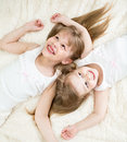 Happy kids lying in pajamas top view on back Stock Image