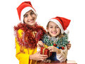 Happy kids opening Christmas gifts Royalty Free Stock Photo