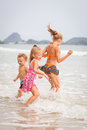 Happy kids playing on beach at day time Stock Image