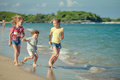 Happy kids playing on beach at the day time Royalty Free Stock Images