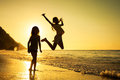 Happy kids playing on beach at the sunrise time Royalty Free Stock Photo