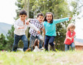 Happy kids playing group of at the park Royalty Free Stock Photo