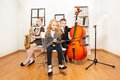 Happy kids playing musical instruments together Royalty Free Stock Photo