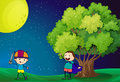 Happy kids playing near the tree illustration of under bright fullmoon Royalty Free Stock Photos