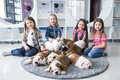 Happy kids with puppies of English bulldog on the floor Royalty Free Stock Photo