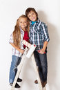 Happy kids ready to paint their room Royalty Free Stock Photo