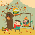 Happy kids ride on a swing in the autumn forest Royalty Free Stock Photo
