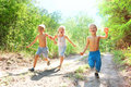 Happy kids running in the woods Royalty Free Stock Image