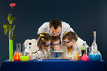 Happy kids with scientist doing science experiments in the laboratory Royalty Free Stock Photo
